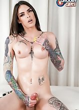 Tattooed superstar Chelsea Marie stroking her big cock until she cums in this hot solo scene!