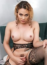 Watch busty tgirl Venus Cuellar showing off her amazing body and stroking her cock until she cums!