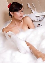 Ladyboy Nueng soaps her naked body in the bathrub