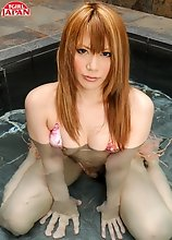 Japanese tgirl Jyuri is out at the beach in her bikini. She leaves the beach back to her beach house and plays with her hard cock in the pool.