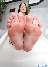 Sarah Oliviera playing with her sexy feet and toes showing them off and her soles while spraying her feet to make them all wet and slippery