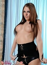 Busty Ashley George posing in sexy leather corset