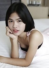 21yo busty Thai shemale strips for the camera to tease her white cock date