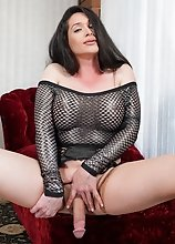 Shemale superstar Penny Tyler strokes her big cock to a full erection. Then she grabs her favorite glass dildo and has some fun with that!