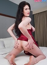 Watch gorgeous Chanel Noir posing, stroking her cock and fucking her tight ass with her toy!